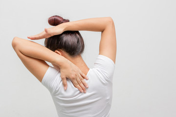 Back view portrait of a young woman stretching hands on  white background