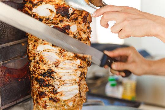 Shawarma meat being cut