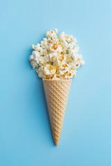 Popcorn in ice cream cones.