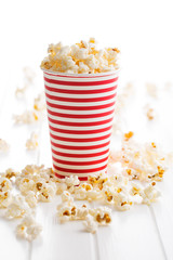 Popcorn in paper cup.