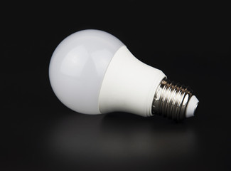 White LED bulb with reflection on black background