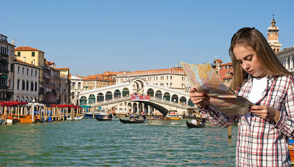Girl with map in hand in Venice near the bridge lovers, Italy, E