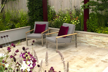 Tranquil garden with a patio and two seats