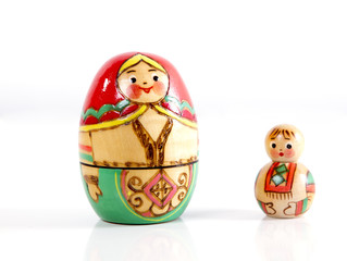 two wooden nesting dolls. mother and son