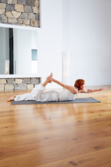 Yoga exercise in wooden floor gym and mirror