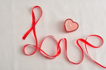 Love written with a red ribbon