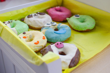 donuts in the form of animals. Multi-colored donuts. Sweets. Box of donuts