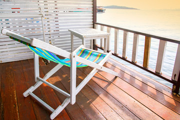 A beach chair and a table on terrace sea view