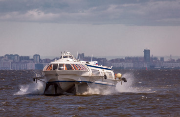 Meteor jet boat traveling by the surface of Baltic sea bay of Saint Petersburg.