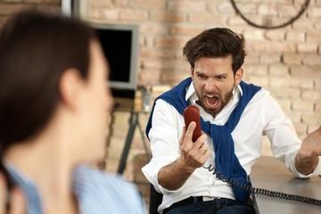 Businessman having a nervous breakdown