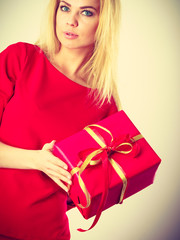 Beautiful woman with red gift.