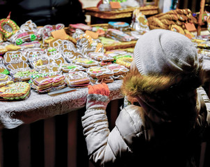 Child at Colorful gingerbreads at the Riga Christmas Market