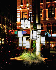 Lanterns illuminated with light at Riga Christmas Market in evening
