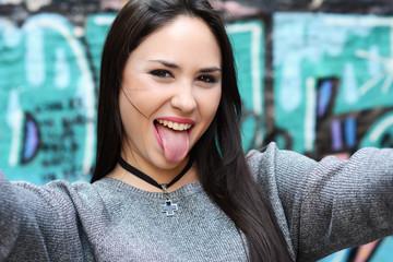 young beautiful woman taking selfie.