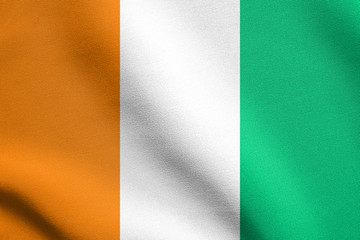 Flag of Ivory Coast waving with fabric texture