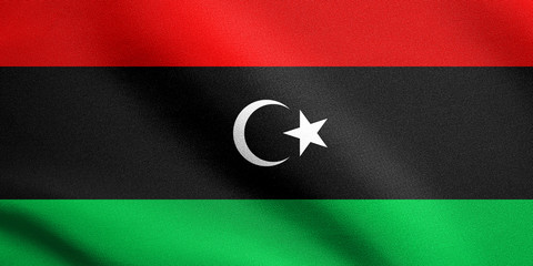 Flag of Libya waving with fabric texture