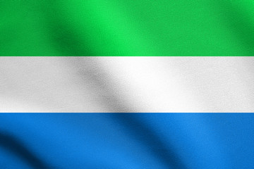 Flag of Sierra Leone waving with fabric texture