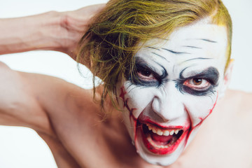 Man with Halloween face art on white background
