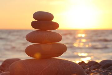 Photo sur Plexiglas Zen pierres a sable Zen stones sunset sea peace of mind concept