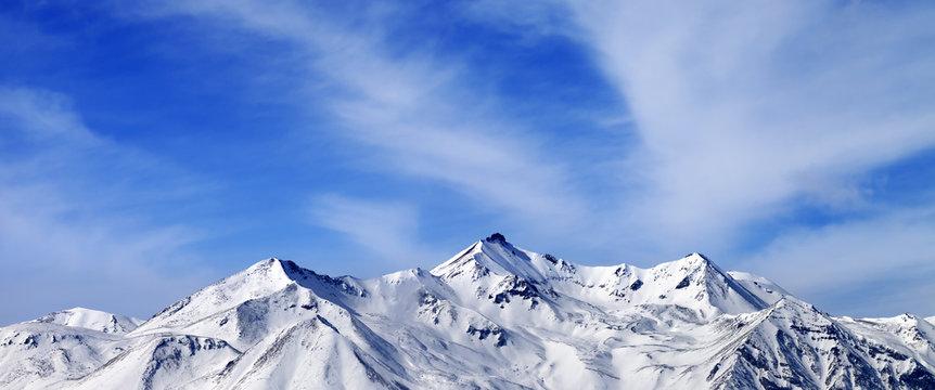 Panoramic view on winter snow mountains