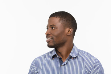 Closeup profile of handsome Afro-American man smiling isolated on white background while posing in studio. Emotions concept.