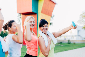 Happy women take photo with mobile phone