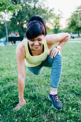Smiling woman doing stretching exercises