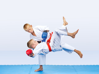 Throws of judo are training athletes with red and blue overlays on his hands