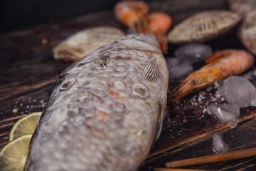 Food wooden background with Seafood, sticks, lime, salt. Copy sp