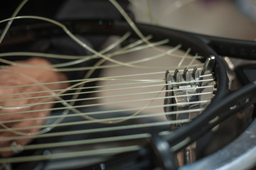 Racket stringing. Detail of tennis racket in the stringing machine