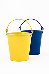 blue and yellow ornamental metal bucket isolated