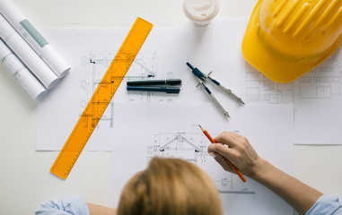 Construction engineer drawing blueprint