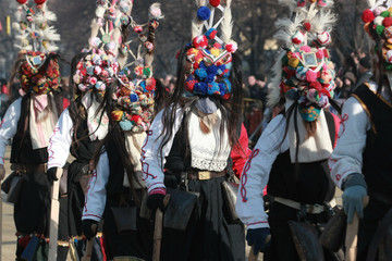 PERNIK, BULGARIA - JANUARY 30, 2016 - Masquerade festival Surva in Pernik, Bulgaria. People with mask called Kukeri dance and perform to scare the evil spirits