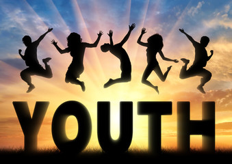 Silhouette people jumping over the word youth