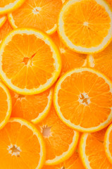 citrus background. juicy slices of orange cover the entire surface