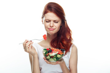 Beautiful woman eating a salad. Isolated background