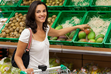 latin woman buying in grocery store
