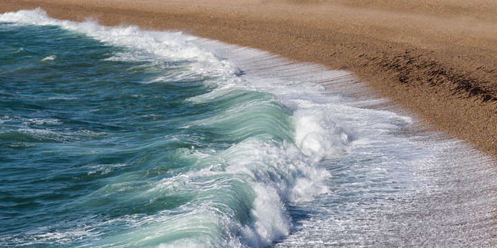 Storm waves breaking on Chesil Beach.