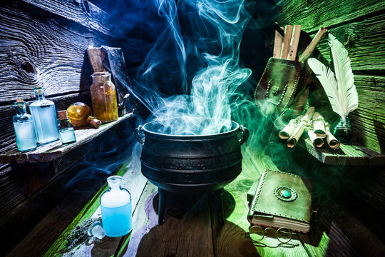 Magical witch workshop with blue and green smoke for Halloween