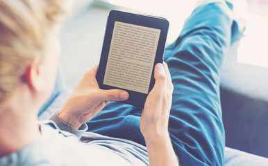 Man reading a book on digital device