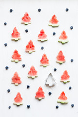 Christmas pattern. Slices of watermelon in the shape of christma