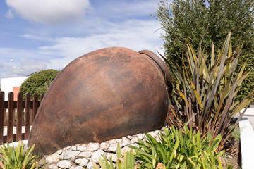 One big ancient ceramic pot in the garden