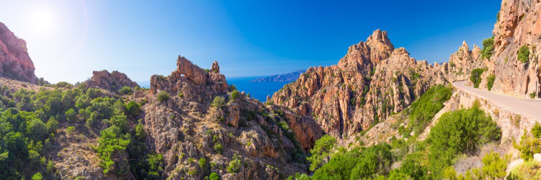 Calanques de Piana with the D81 coastline road on the west coast of Corsica, France