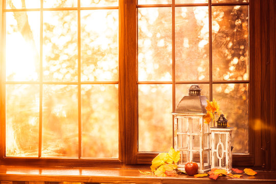 Vintage lanterns at the windowsill. Autumn background