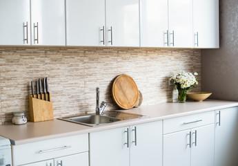 interior of new bright white home kitchen