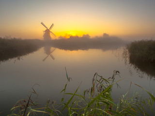 Wall Mural - Windmill on a lake