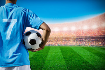 soccer football player no.7 in blue team concept holding soccer