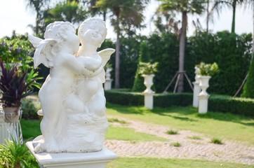 Cupid statue in garden