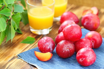 Plum juice and ripe fresh fruit