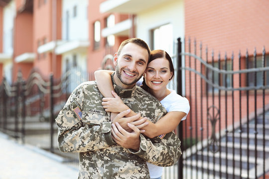 Happy US army soldier with wife on street